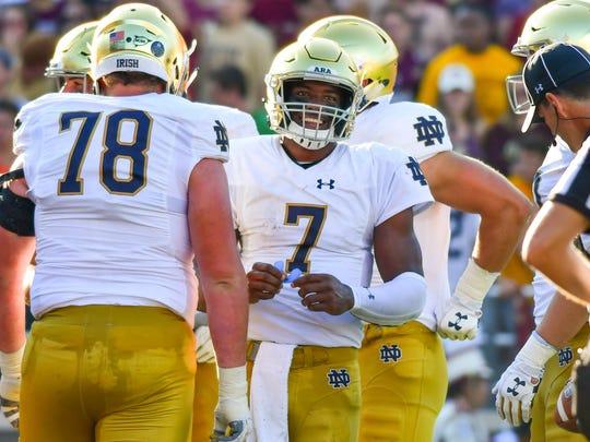 Notre Dame Fighting Irish quarterback Brandon Wimbush (7) smiles after scoring a touchdown in the second quarter against the Boston College Eagles at Alumni Stadium.