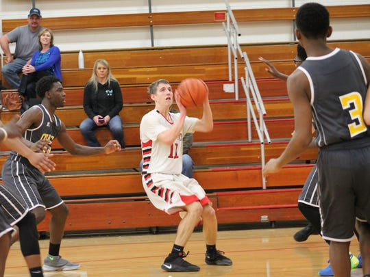 Dominic Ruwe prepares to launch a three-pointer against
