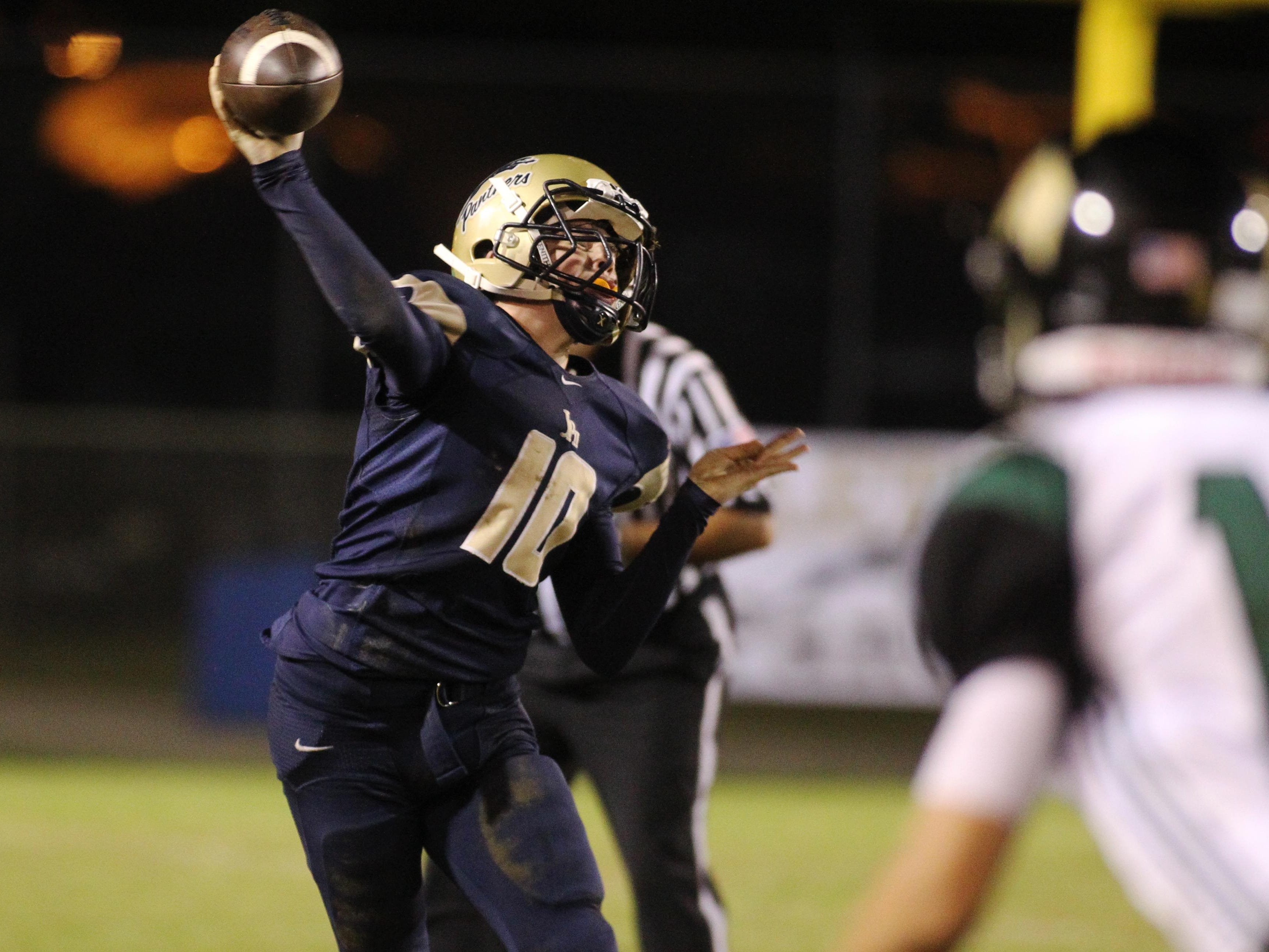 John Paul II quarterback Brian Woodend throws a pass in the championship game of the North Florida Football Conference at Gene Cox Stadium.