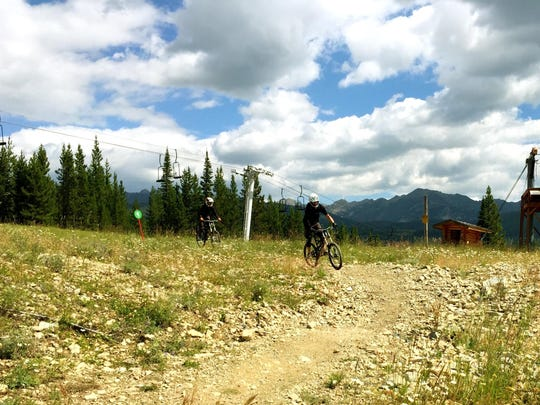 Jimmer Gillispie, right, and Sheila D'Amico ride a trail at Big Sky Resort.