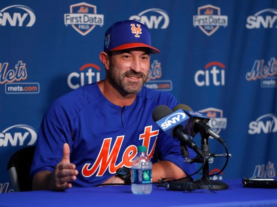 FILe - In this Feb. 13, 2018, file photo, New York Mets manager Mickey Callaway speaks during a news conference ahead of the official start of spring training baseball practice, in Port St. Lucie, Fla. The Mets home opener is scheduled for March 29 against the St. Louis Cardinals. (AP Photo/Jeff Roberson, File)