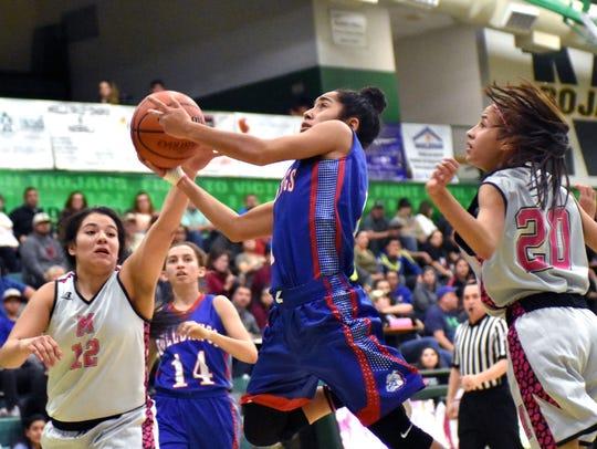 Las Cruces High's Brooke Salmon splits Trojan defenders