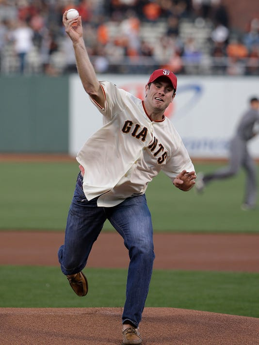 Former Stanford quarterback Kevin Hogan throws the ceremonial first pitch before a baseball game between the San Francisco Giants and the Arizona Diamondbacks in San Francisco, Monday, April 18, 2016. (AP Photo/Jeff Chiu)