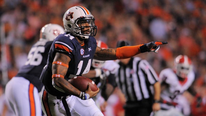 Though his passing is still a work in progress, quarterback Nick Marshall has been adept at running the zone read, requiring quick decisions about whether to keep the ball or hand off.