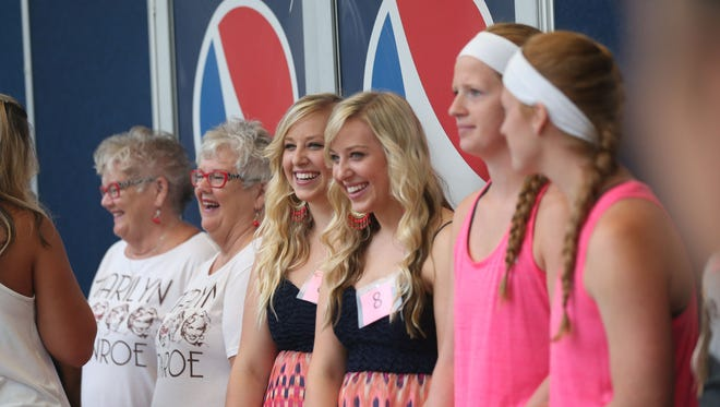 Three sets of twins compete in the twins, triplets and more contest at the Iowa State Fair on Thursday morning, Aug. 11, 2016, in Des Moines.
