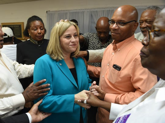 Local ministers and leaders pray and lay hands on mayoral