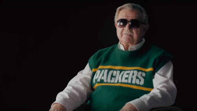"""Legendary Bears coach Mike Ditka dons a Packers sweater for a McDonald's commercial. Could the """"Ditka Curse"""" be hurting the Packers?"""
