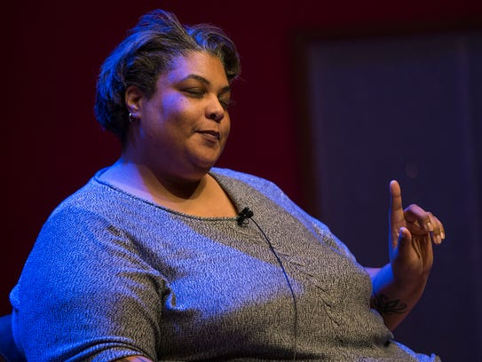 Author Roxane Gay makes the crowd laugh as she holds