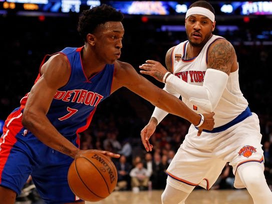 Stanley Johnson drives past Carmelo Anthony.