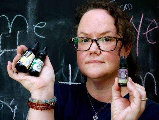 Shea Brock, who suffers from back pain uses CBD oils