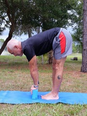 Gary Granza of Ruby and Pearls and Bija Yoga demonstrates supported Forward Fold.