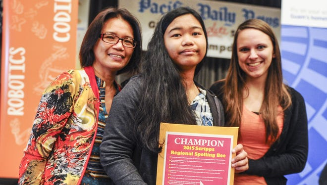 This file photos shows the 2015 Scripps Regional Spelling Bee champion, Justine Calayo, center, with her mother, Des Calayo, left, and her spelling coach, Joanna Marie Dubiel, after last year's regonal spelling competition.
