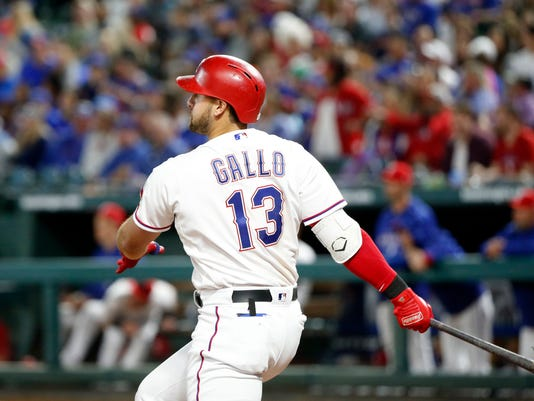 Texas Rangers hitter Joey Gallo (13) watches his double against the Houston Astros during the seventh inning of a baseball game Friday, March 30, 2018, in Arlington, Texas. (AP Photo/Michael Ainsworth)