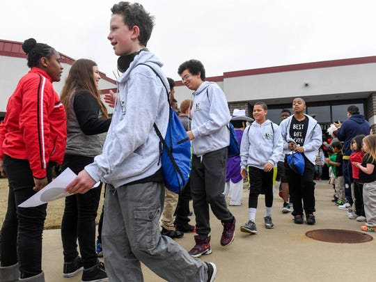 Students from Glenwood Leadership Academy, Cedar Hall Community School and McGary Middle School get a send off from the Glenwood student body as they leave for a trip to Disney World Wednesday, January 18, 2017.