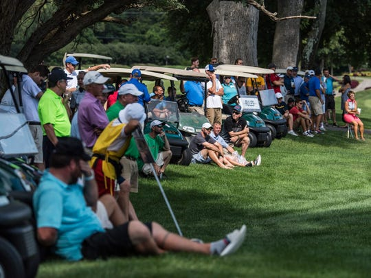A large crowd of spectators gather to watch the sudden death playoff between Matthew Ladd and Spencer Wagner during the 2017 Evansville Courier & Press Men's City Golf Tournament held at the Evansville Country Club in Evansville, Ind., on Sunday, Aug. 13, 2017. Ladd won the 2017 championship title after competing the five hole playoff.