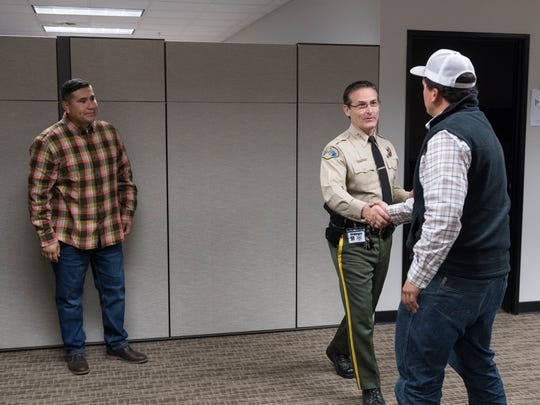 Tulare County Sheriff Mike Boudreaux presents the STAR (Sheriff  of Tulare Action Recognition) Award to Michael Correia, right, and Carlos Martinez on Tuesday, November 28, 2017. Martinez helped save a man attempting suicide. Corriea stopped to help extinguish a vehicle fire on Highway 65.