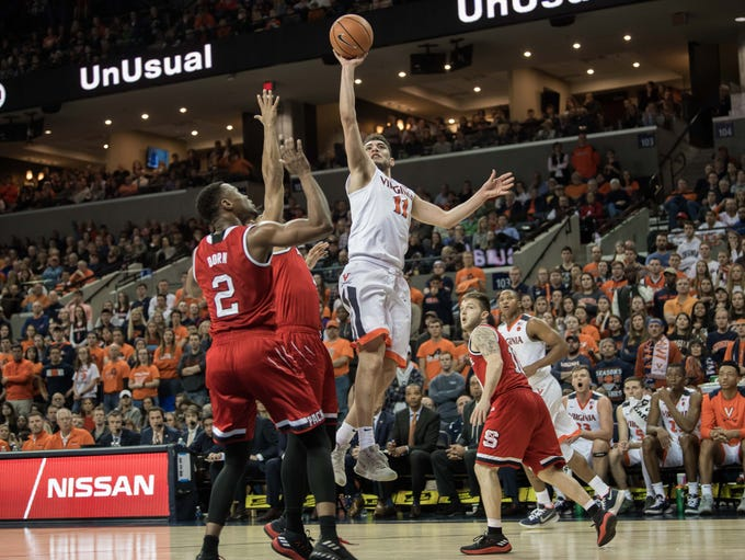 Virginia Cavaliers guard Ty Jerome (11) shoots against