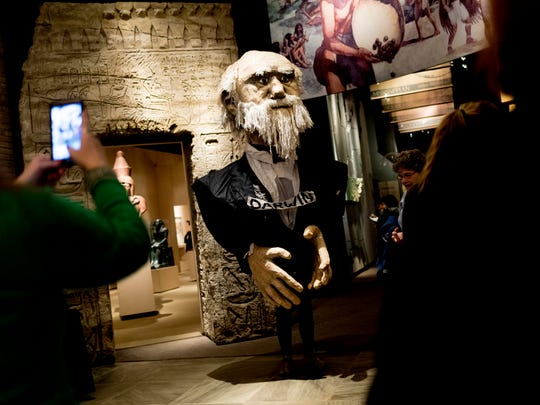 A Charles Darwin puppet, played by UT grad student Audrey Martin, greets visitors at the Darwin Day birthday celebration at McClung Museum of Natural History and Culture in Knoxville, Tennessee on Saturday, February 10, 2018. The celebration, which has been held since 1997, aims to combat misunderstandings of scientific principles, particularly in the field of evolutionary biology.