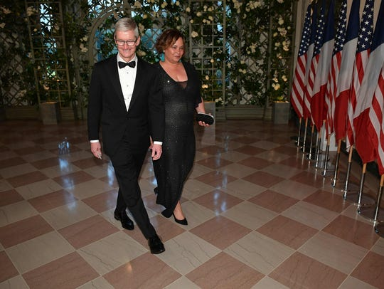 CEO of Apple Tim Cook arrives with Lisa Jackson, former