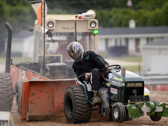 Tyler Reckelberg's front wheels get lifted up as he competes in the tractor pull in 2013.
