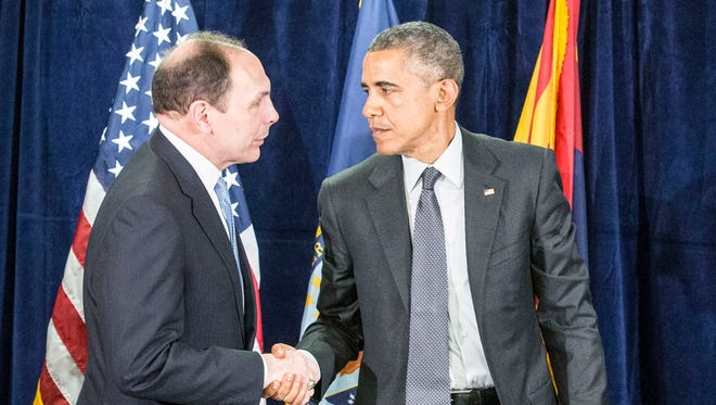 President Obama joined by Secretary of Veterans Affairs Bob McDonald, (left), and Former USAA CEO Josue Robles (right), came to discuss veterans issues at the Phoenix VA Medical Center on March 13, 2015.