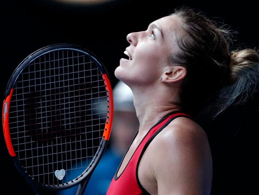 Romania's Simona Halep celebrates after defeating Germany's Angelique Kerber in their semifinal at the Australian Open tennis championships in Melbourne, Australia, Thursday, Jan. 25, 2018. (AP Photo/Vincent Thian)