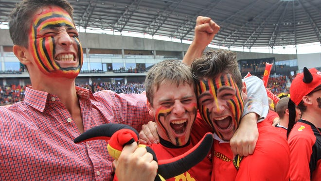 Fans of the Belgian national soccer team cheer during the match against Algeria, broadcast live on a giant video screen at the Ghelamco soccer stadium in Ghent, western Belgium on Tuesday.