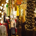 Shoppers look in store windows along Collingswood's Haddon Avenue shopping and dining corridor.