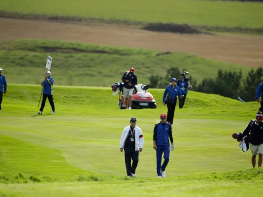 US team captain Tom Watson, left, walks along the 14th fairway with Jordan Spieth of the US during a practice round ahead of the Ryder Cup golf tournament at Gleneagles, Scotland, Thursday, Sept. 25, 2014. (AP Photo/Matt Dunham)