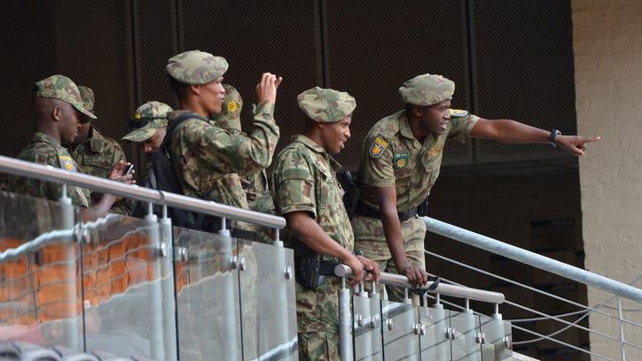 Military police patrol FNB Stadium on Monday ahead of Nelson Mandela's memorial service in Johannesburg on Tuesday.
