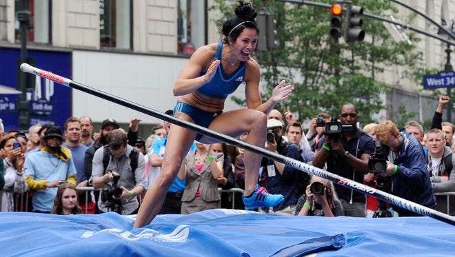 Olympic gold medalist Jenn Suhr celebrates after clearing the bar to win the adidas Grand Prix pole vault & IAAF-Nestle kids event in Herald Square in New York.