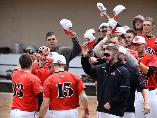 St. Cloud State's Zach Hoffmann (33) is met by teammates after hitting a home run against Concordia during the ninth inning of the NSIC championship game Sunday, May 15, at Joe Faber Field in St. Cloud.