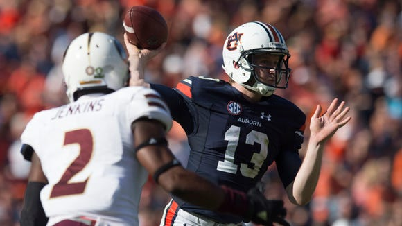 Auburn Tigers quarterback Sean White (13) throws a pass as Louisiana Monroe Warhawks safety Roland Jenkins (2) rushes him during the Auburn vs. ULM NCAA football game on Saturday, Oct. 1, 2016, in Auburn, Ala.