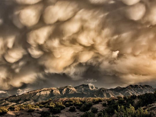 "This year's Grand Prize Winner for the New Mexico Magazine Photography Contest is from the Landscape category and is titled, ""Storm Over the Sandia Mountains."" The photo was taken by Michael Edminster from Placitas, NM."