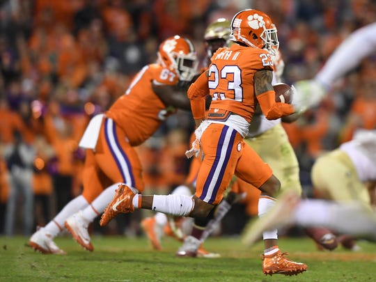 Clemson defensive back Van Smith (23) returns the ball after intercepting a Florida State pass during the 4th quarter on Saturday, November 11, 2017 at Clemson's Memorial Stadium.