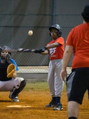 Ka'doffe Mathis, 12, gets a hit during a game at Pelican