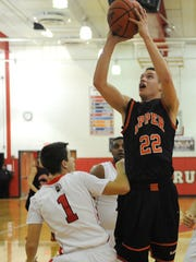 Wes Vent shoots the ball for Upper Sandusky during their game against Bucyrus Friday night.