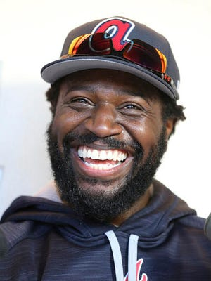 Atlanta Braves new infielder Brandon Phillips smiles during an interview at the teams spring training facility in Lake Buena Vista, Fla., Friday, Feb. 17, 2017.  (Curtis Compton/Atlanta Journal-Constitution via AP)
