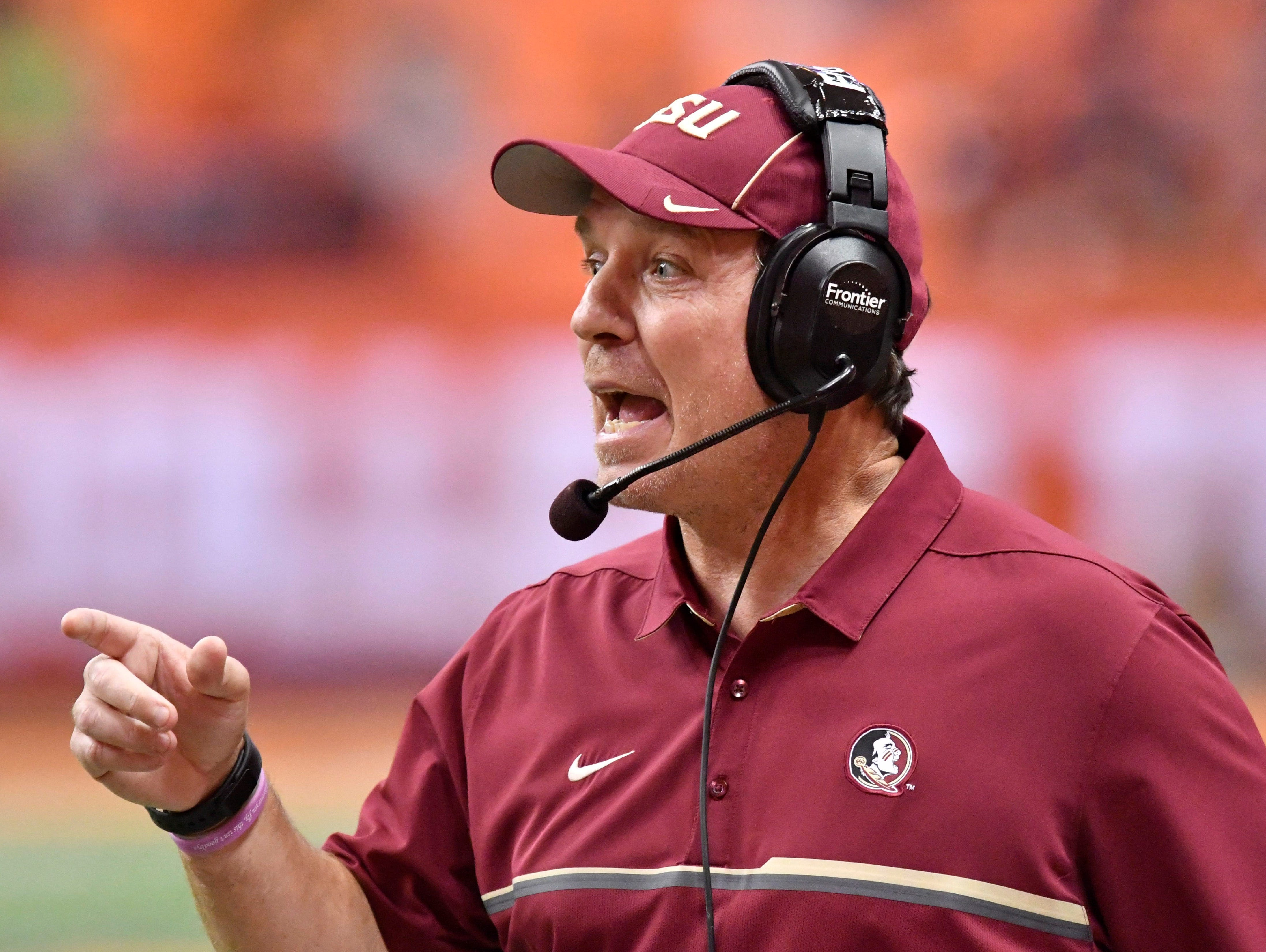 Nov 19, 2016; Syracuse, NY, USA; Florida State Seminoles head coach Jimbo Fisher has a word with an official to dispute a call during the fourth quarter of a game against the Syracuse Orange at the Carrier Dome. Florida State won 45-14. Mandatory Credit: Mark Konezny-USA TODAY Sports