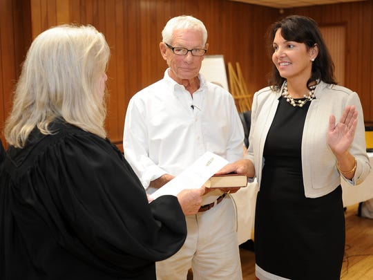 Incumbent, re-elected Commissioner Kathy McGuiness and newcomer Lisa Schlosser were also sworn into office in Rehoboth Beach on Friday.
