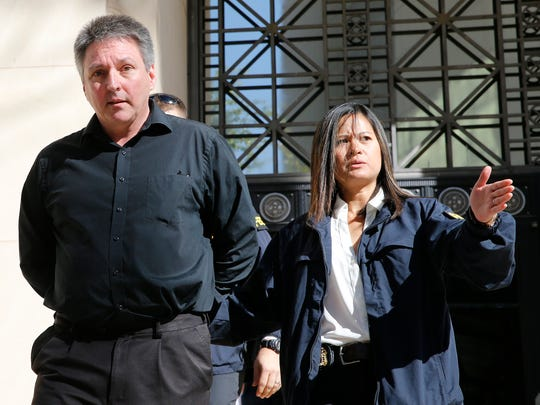 Former Austin High School Principal John Tanner is led to the El Paso County Jail after surrendering to the FBI in connection with the El Paso Independent School District cheating scandal.