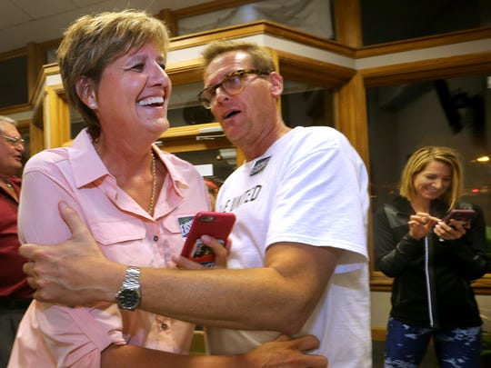 Lisa Eischeid, left, is congratulated by campaign member Bill Wilson, right, at the Election Commision office in Murfreesboro, after it appears that Eischeid won the General Sessions Judge race on Thursday, Aug. 4, 2016, with only one outstanding precinct.