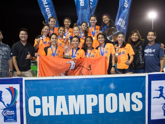 The Lady Crushers pose with the champions trophy and