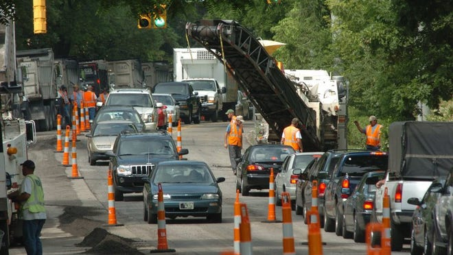 Construction crews in June 2005 resurface Kingston Pike between Neyland Drive and Towanda Trail after KUB installed a water main. J. Miles Cary The Knoxville News Sentinel Staff