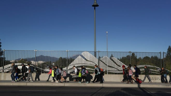Children from Sequoia Middle School participate in Walk to School Day on Wednesday by walking from the Sundial Bridge to the school.