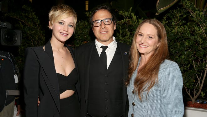 Jennifer Lawrence, director David O. Russell, and actress Melissa Leo attend the reception for 'An Evening With David O. Russell' special tribute during AFI FEST 2013