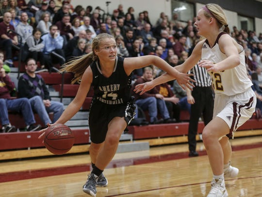 Ankeny Centennial junior Sydney Wycoff drives the ball inside against Ankeny High sophomore Jaelynn Kueker, right, on Friday, Jan. 27, 2017, at Ankeny High School in Ankeny.