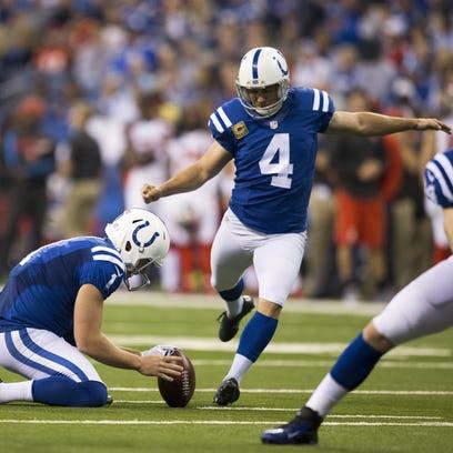 Indianapolis Colts kicker Adam Vinatieri (4) kicks