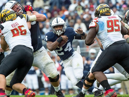 Penn States Miles Sanders (24) drives the ball past