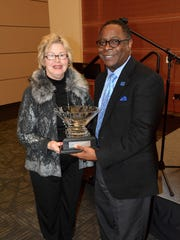 Connie J. Smith, director of Advanc-ED Tennessee, presents MTSU President Sidney A. McPhee on Thursday with the organization's 2016 Leadership in Education Award for his efforts to support STEM (science, technology, engineering and mathematics) learning in primary, secondary and higher education.
